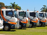 trucks in a row quality towing and tilt tray service