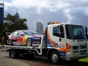 red bull v8 race car on quality towing truck perth western australia